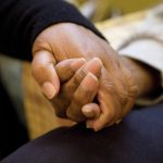 _mg_3446-elderly-female-carer-holding-hand-of-husband-copy